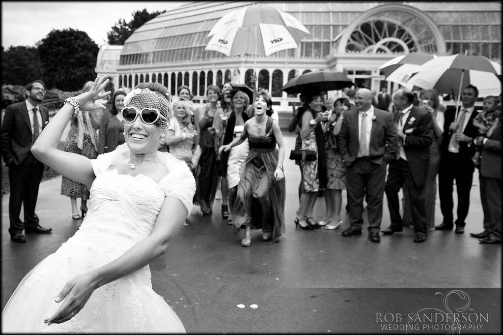 bride throws her bouquet outside the palm house