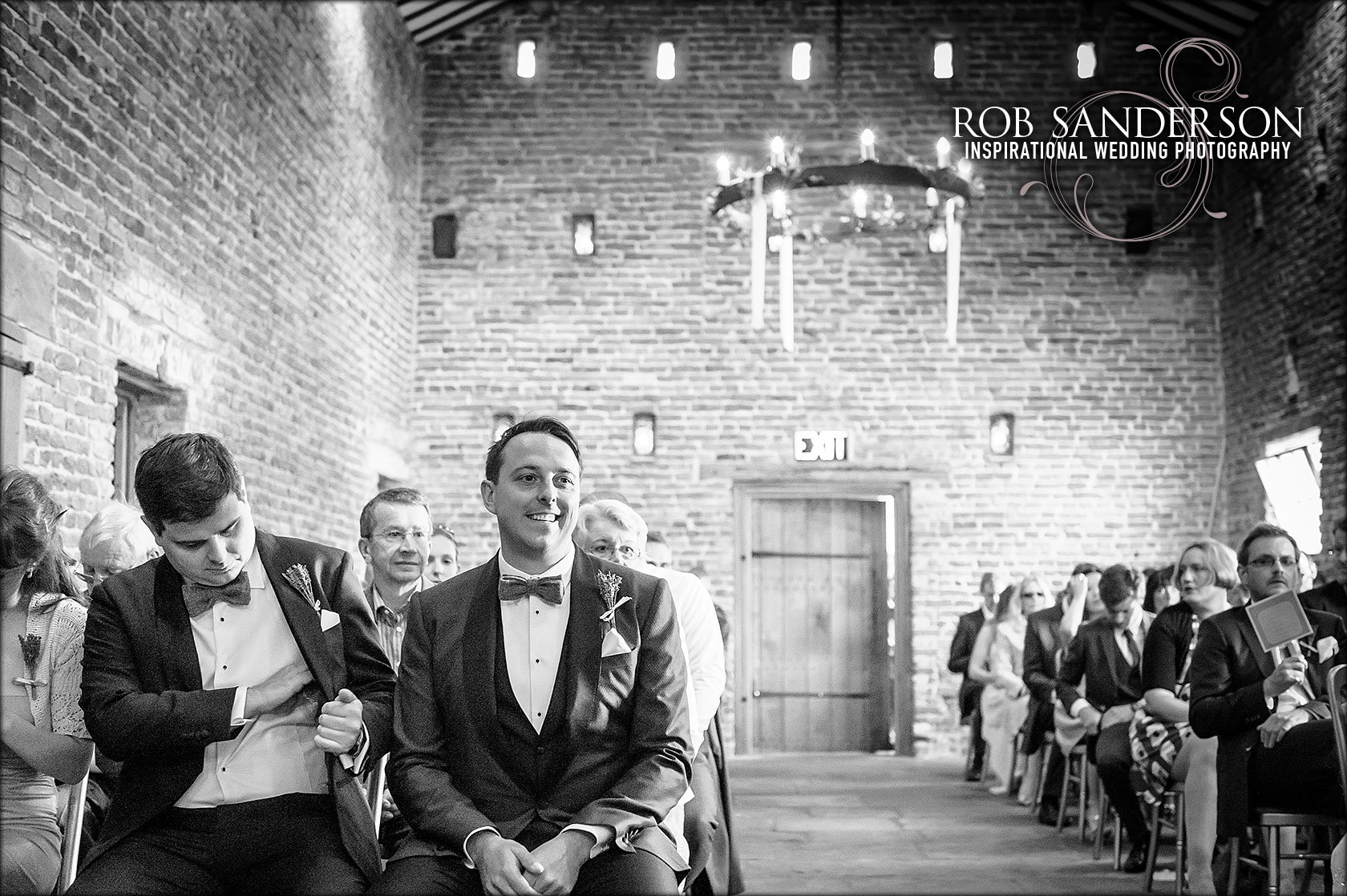 happy groom waits for his brides arrival at Meols Hall