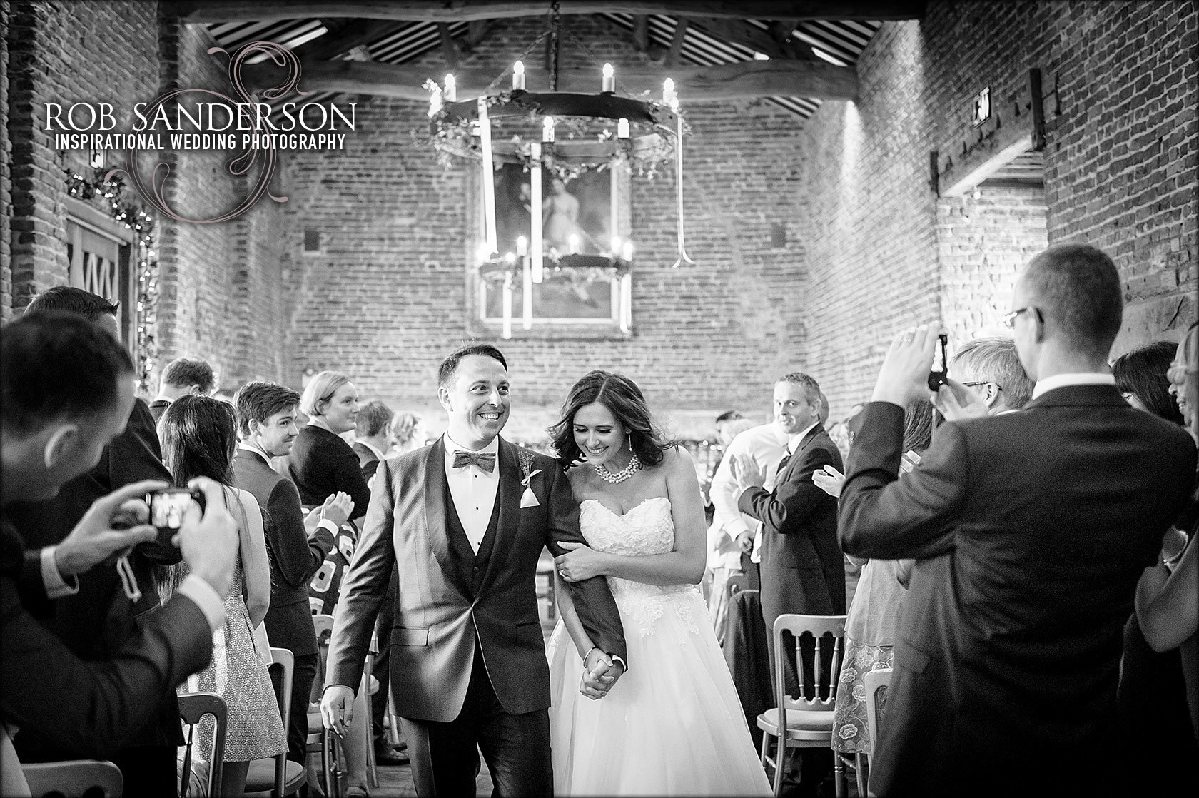 married couple walk back down the aisle Meols hall laughing