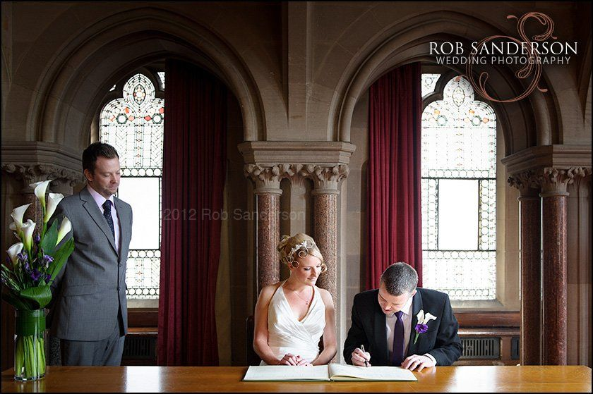 Signing the wedding register at Manchester Town Hall