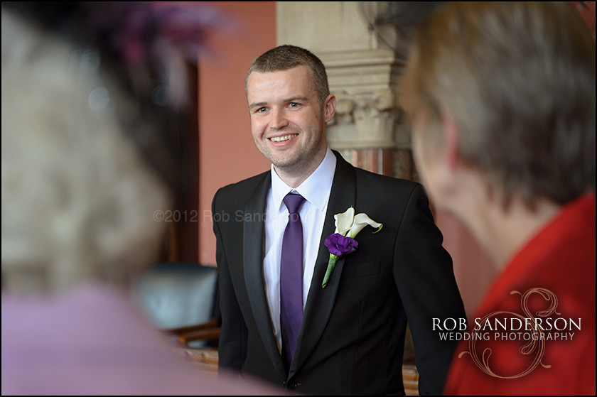 smiling groom at Manchester Town Hall