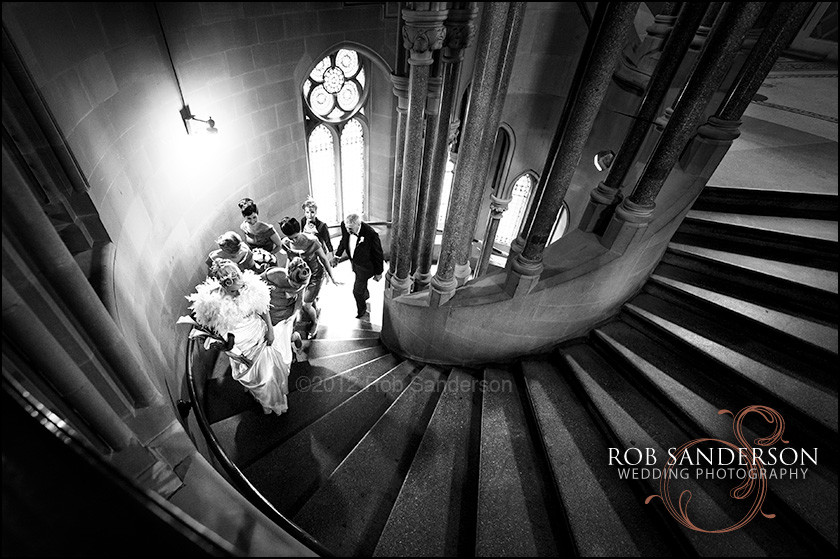 bride walks up the stunning Manchester Town Hall staircase