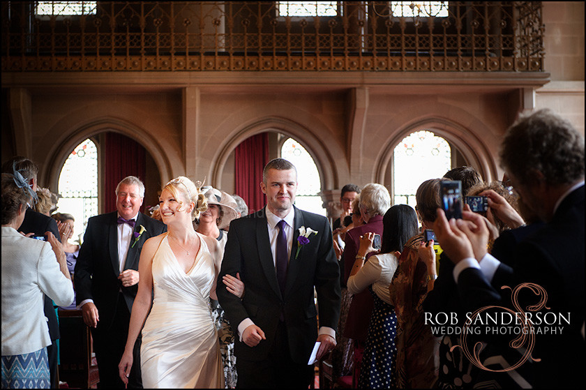 married couple walk back down the aisle