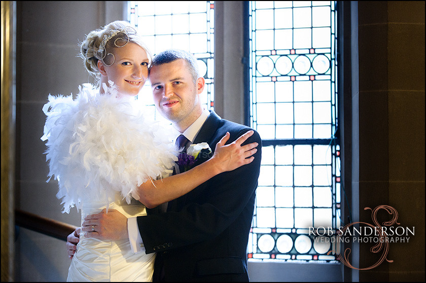 Couple pose inside Manchester Town Hall