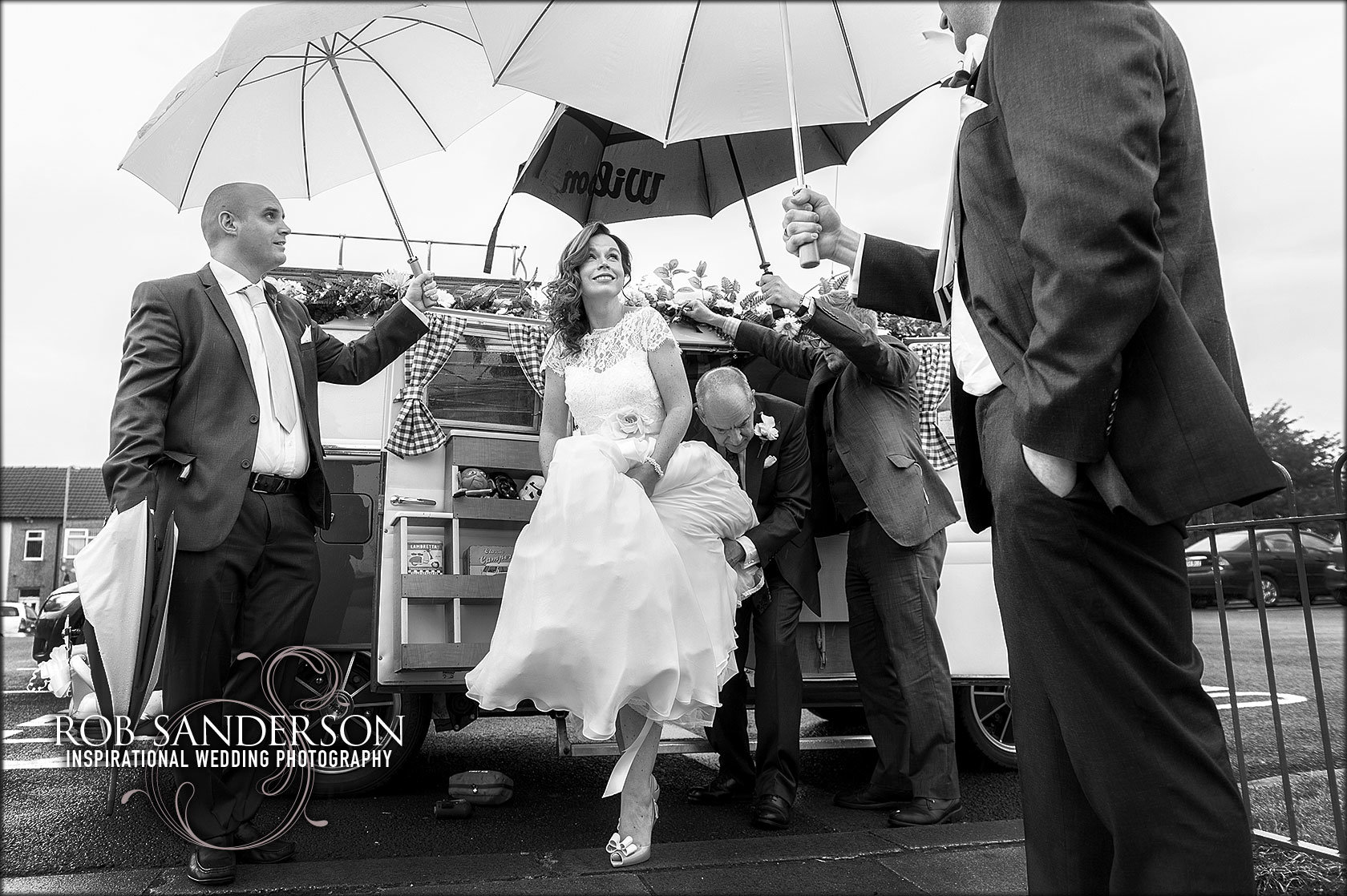 bride arrives for cool rainy wedding