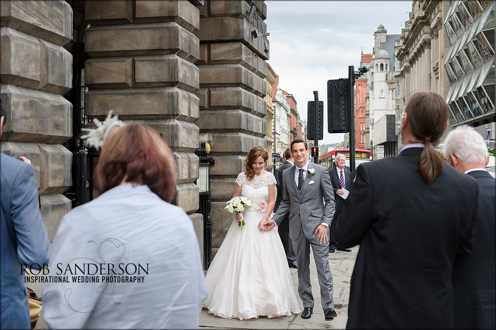 Bride and groom arrive at Liverpool Town Hall