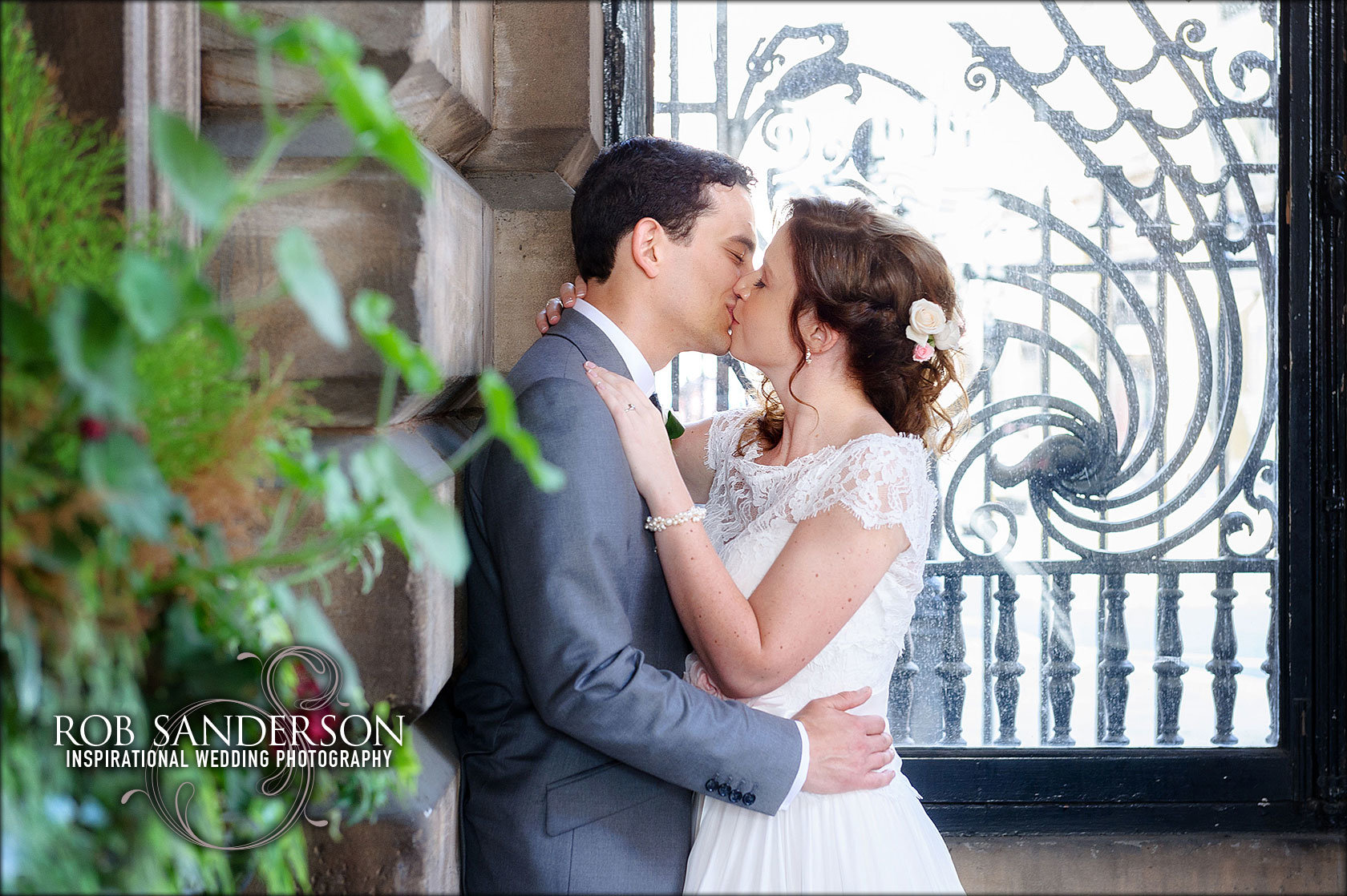 Bride and groom share a kiss outside Liverpool Town Hall
