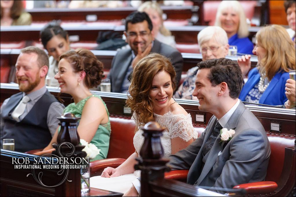 Liverpool Town Hall bride laughing at speeches with new husband