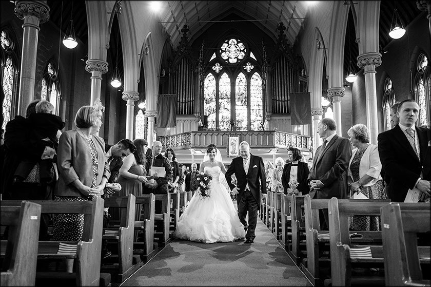 Bride walks down the aisle at St Francis Xaviers in Liverpool