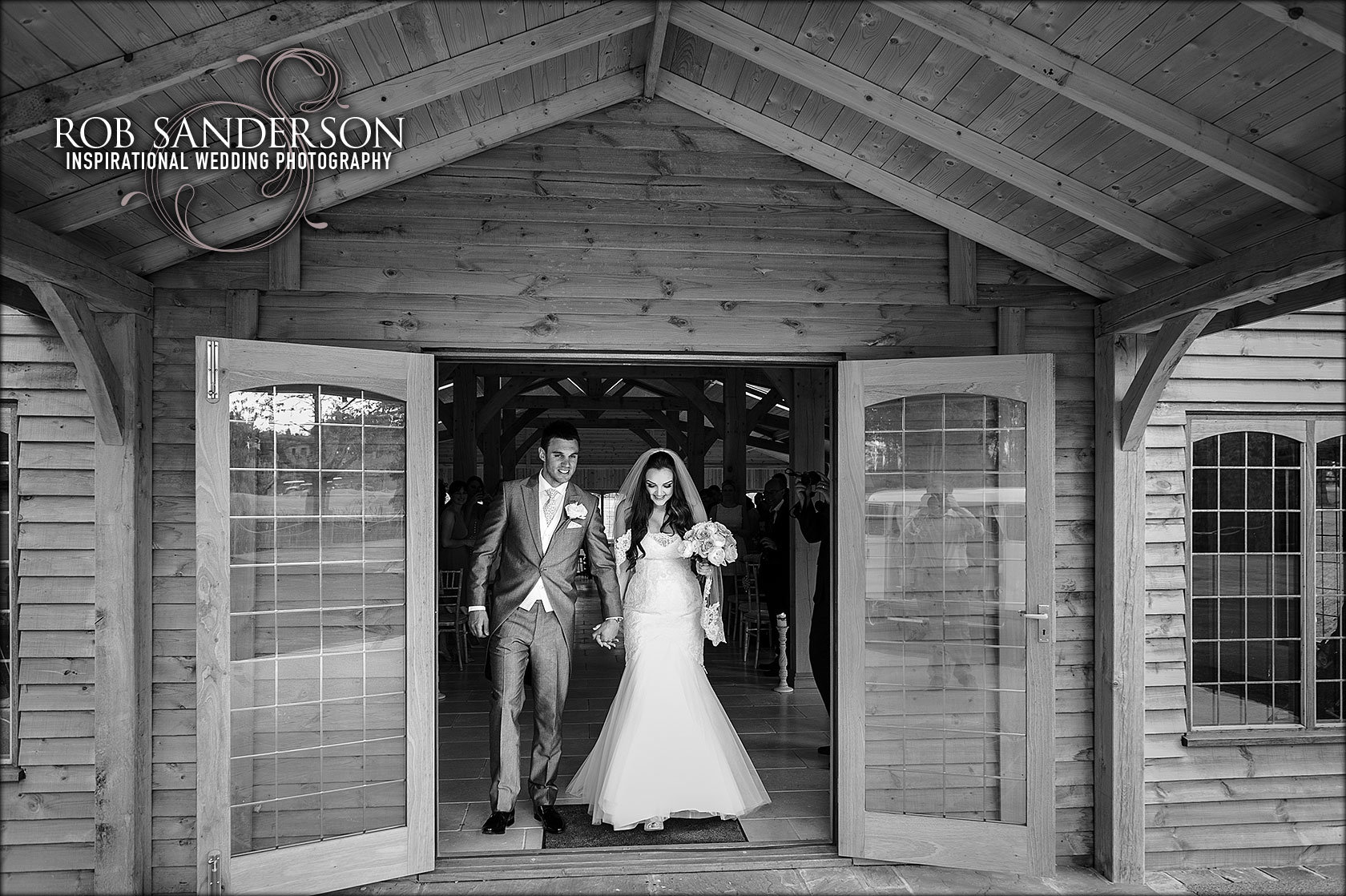 bride and groom exit the stables