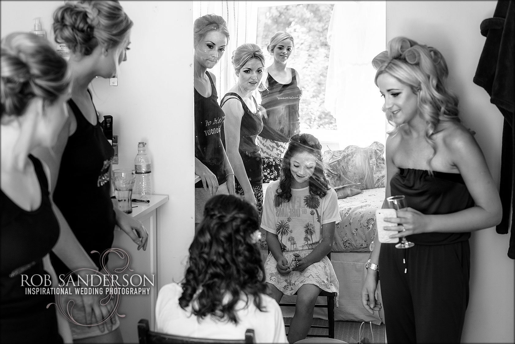 an intimate moment between bride and bridesmaids