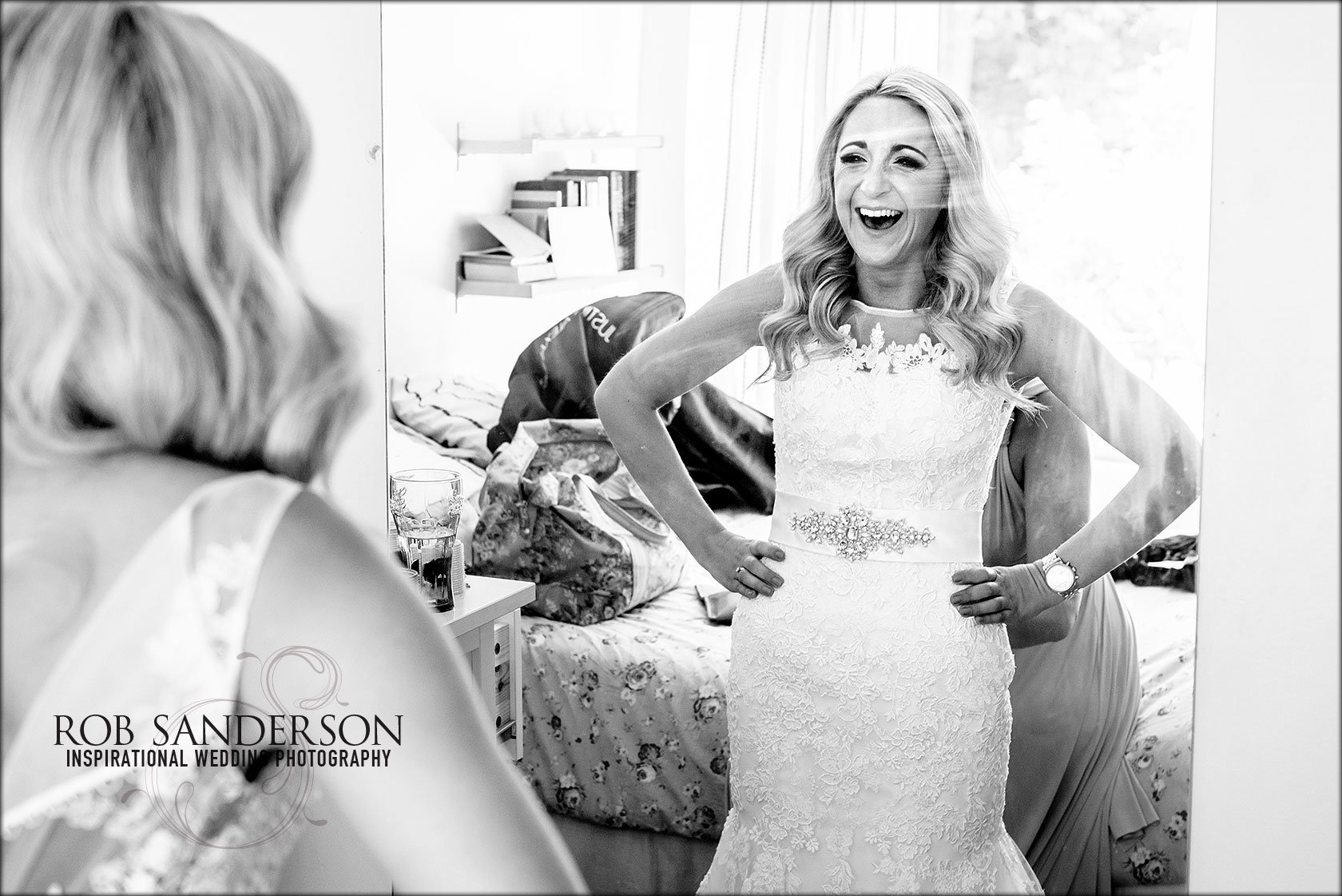 bride sees herself in her wedding dress for the first time in the mirror