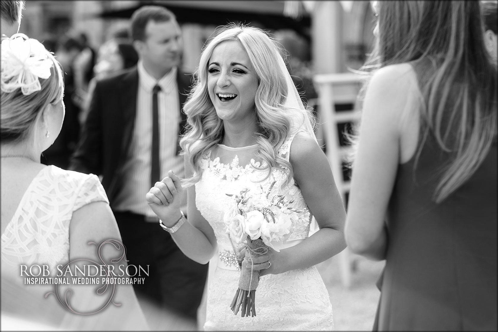Mia looks gorgeous in her wedding dress outside Soughton Hall