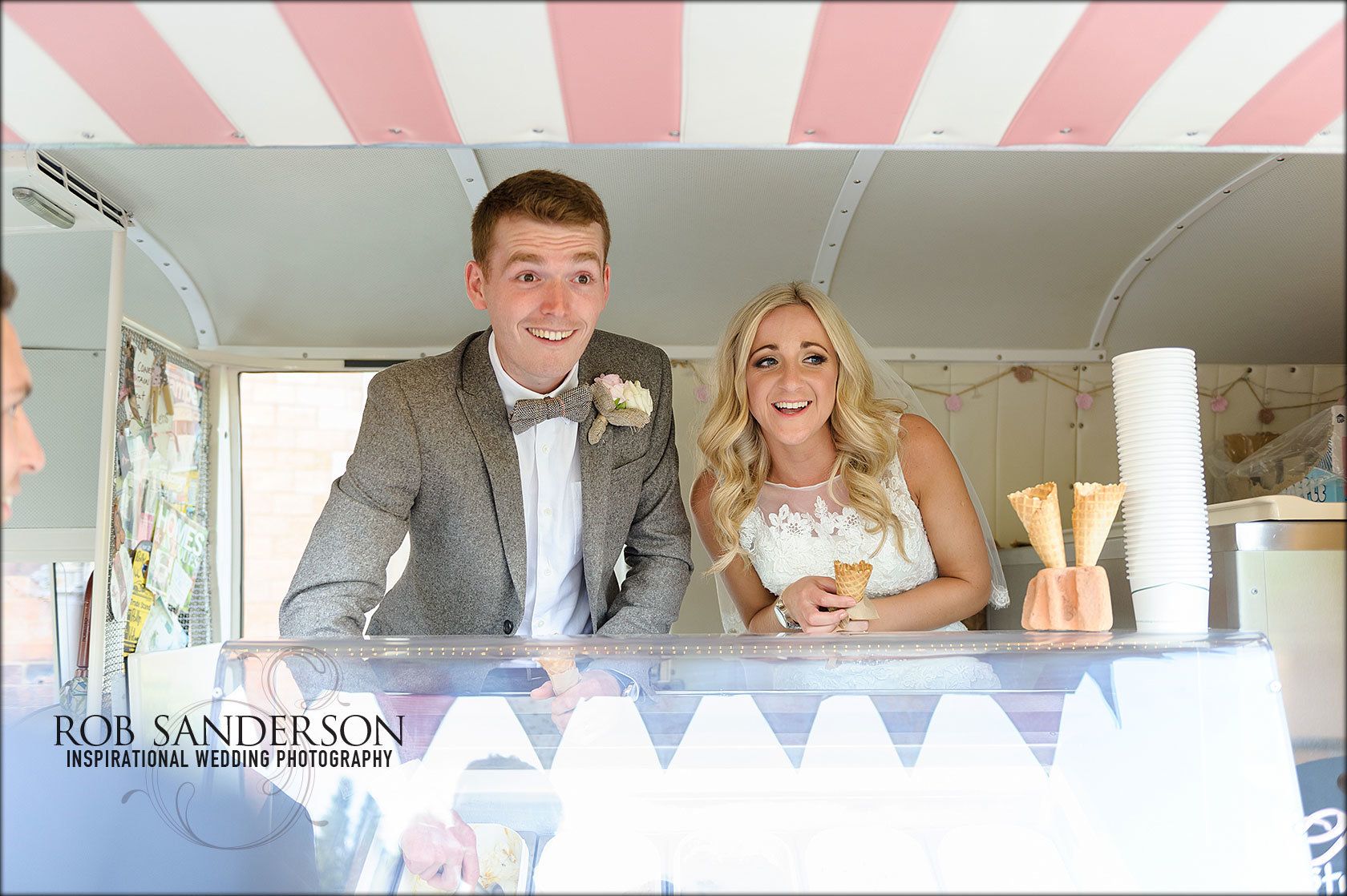 Bride and groom serve ice cream from a vintage ice cream van at Soughton Hall