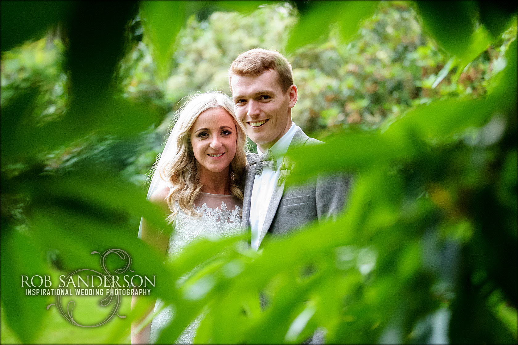 wedding couple are all smiles at Soughton Hall