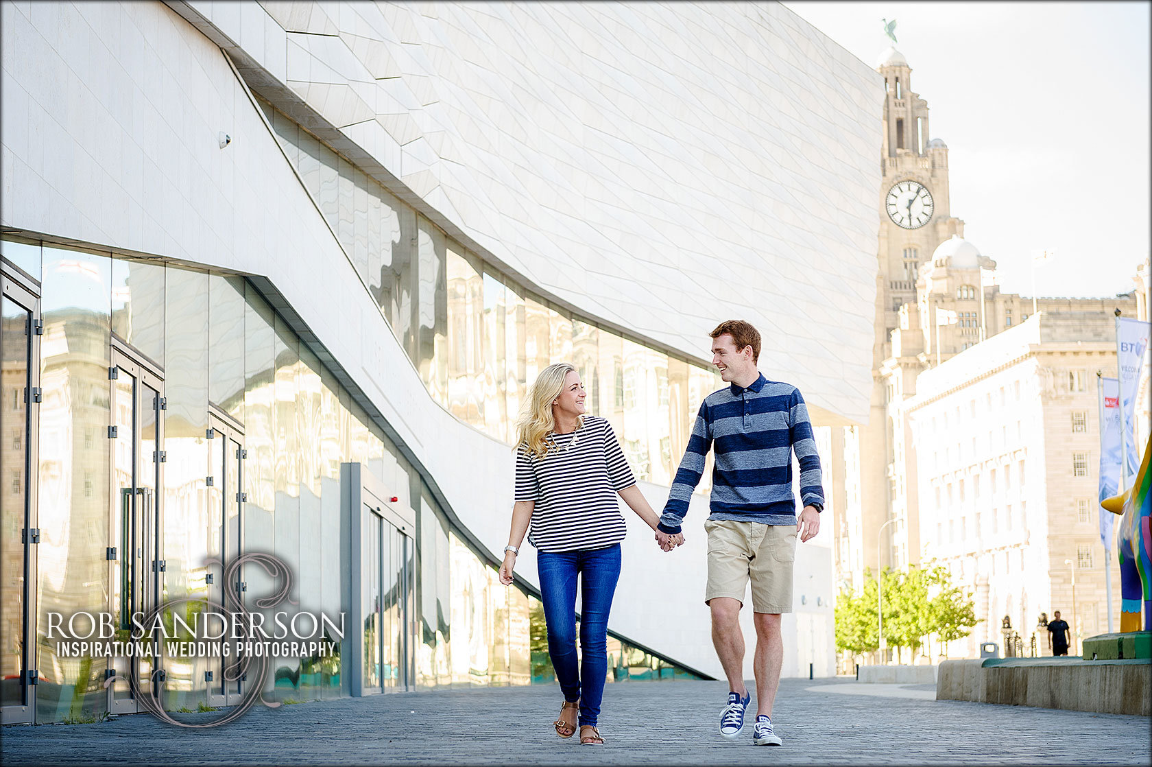 Liverpool engagement photographer with Liver building