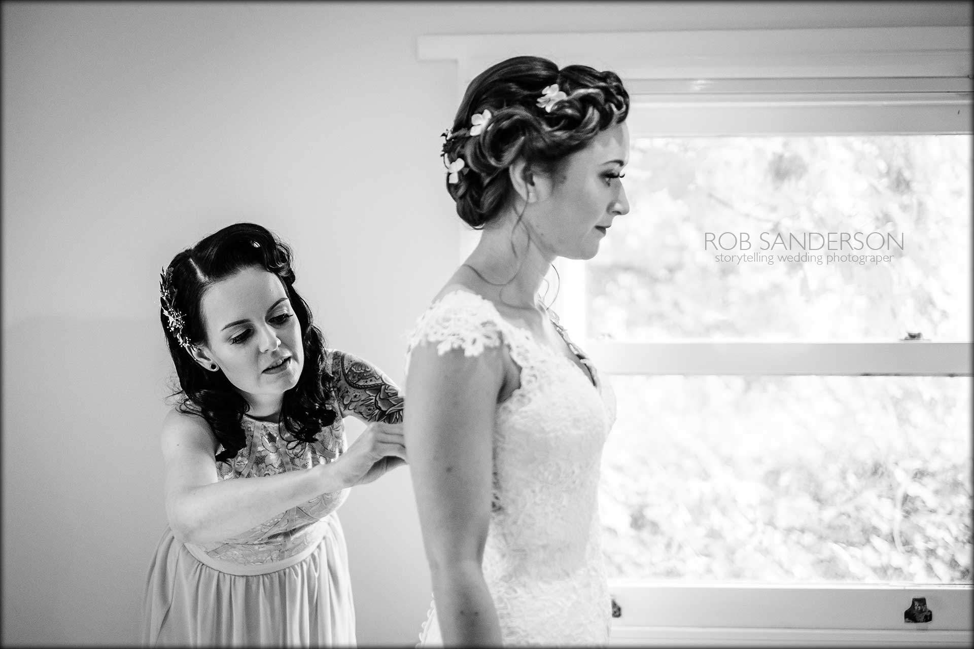 putting on her wedding dress