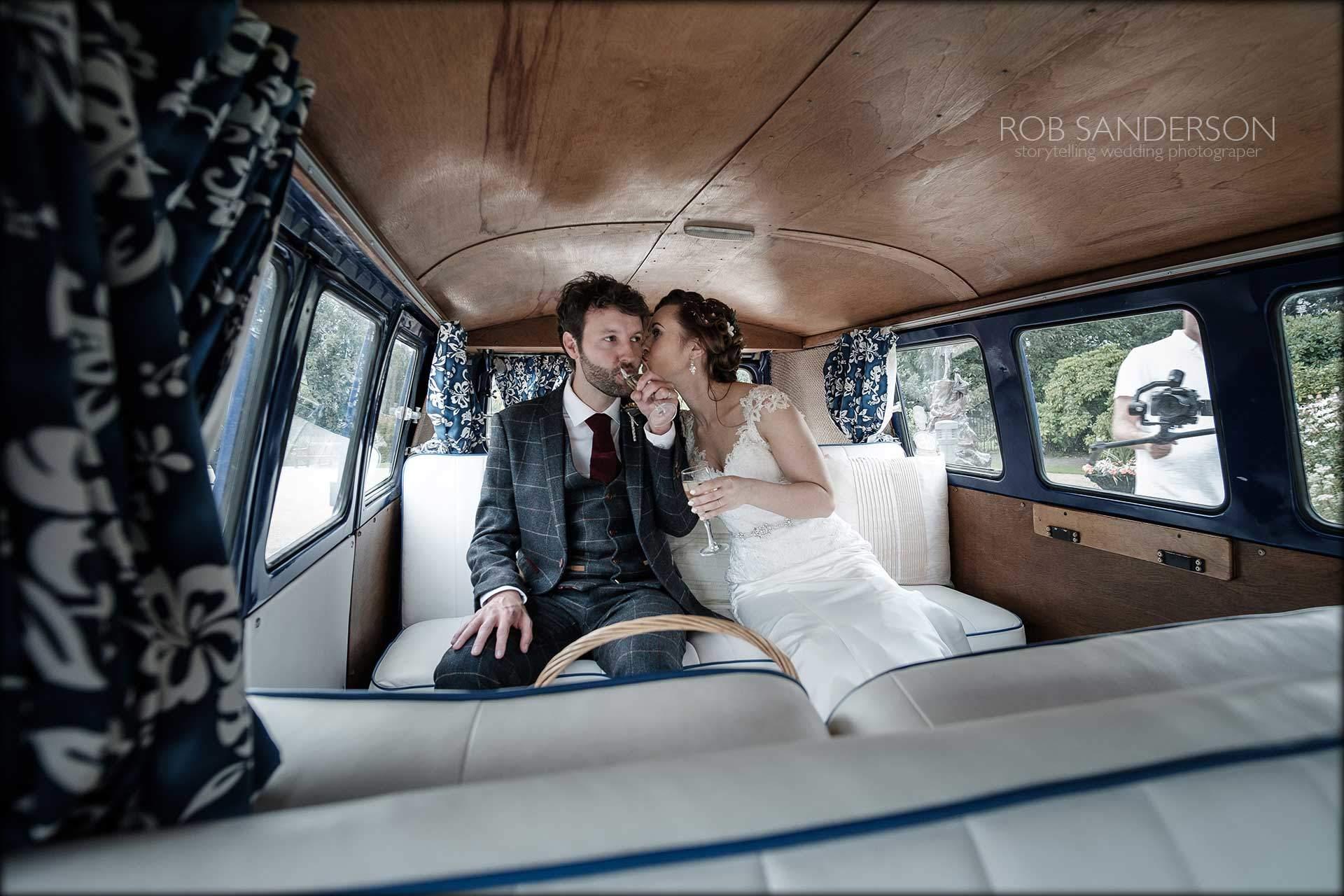 bride and groom in VW camper Van
