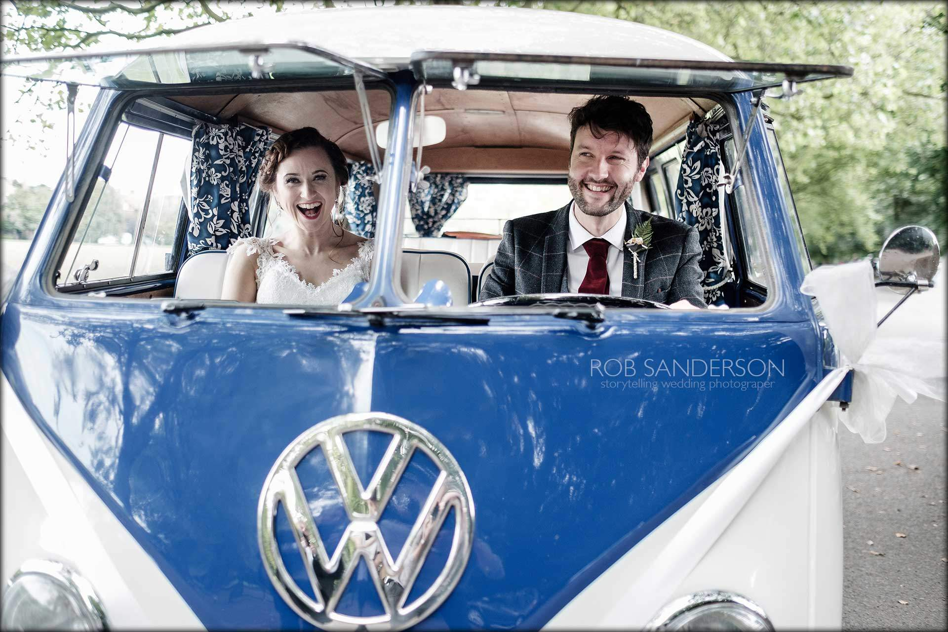 bride and groom have fun in VW camper Van