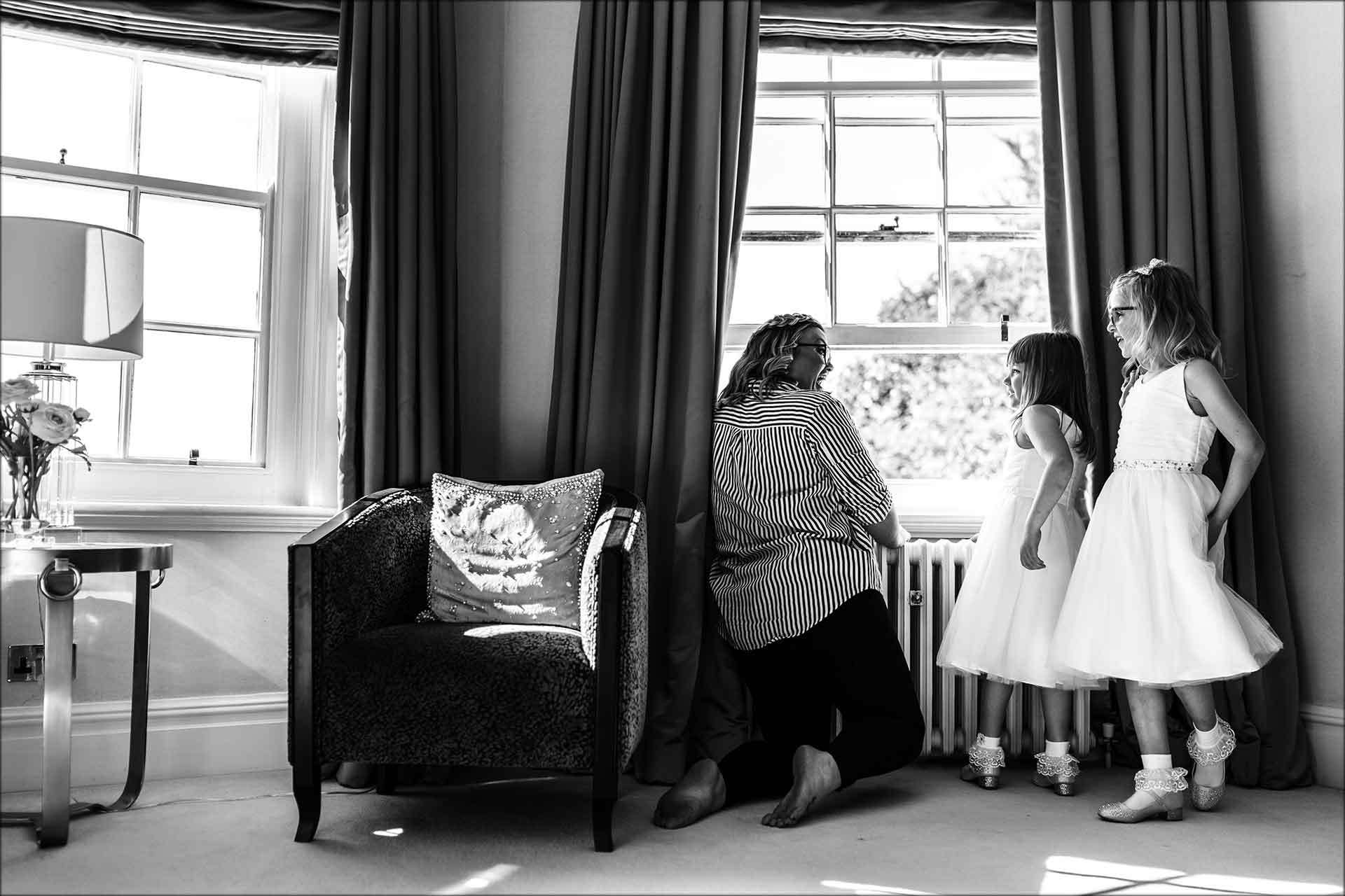 Flower girls looking out of the window