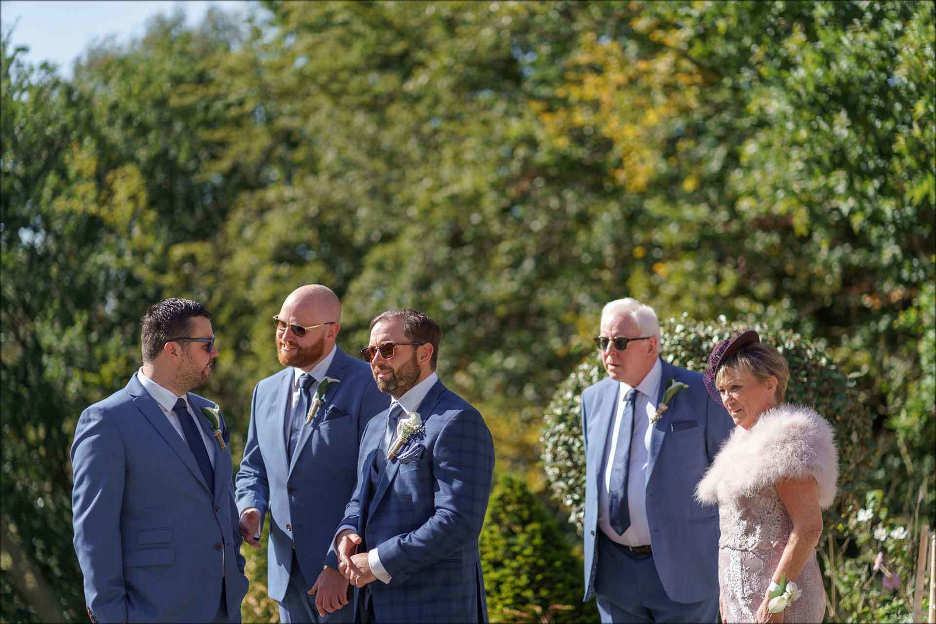 Groom and groomsmen wait for brides arrival