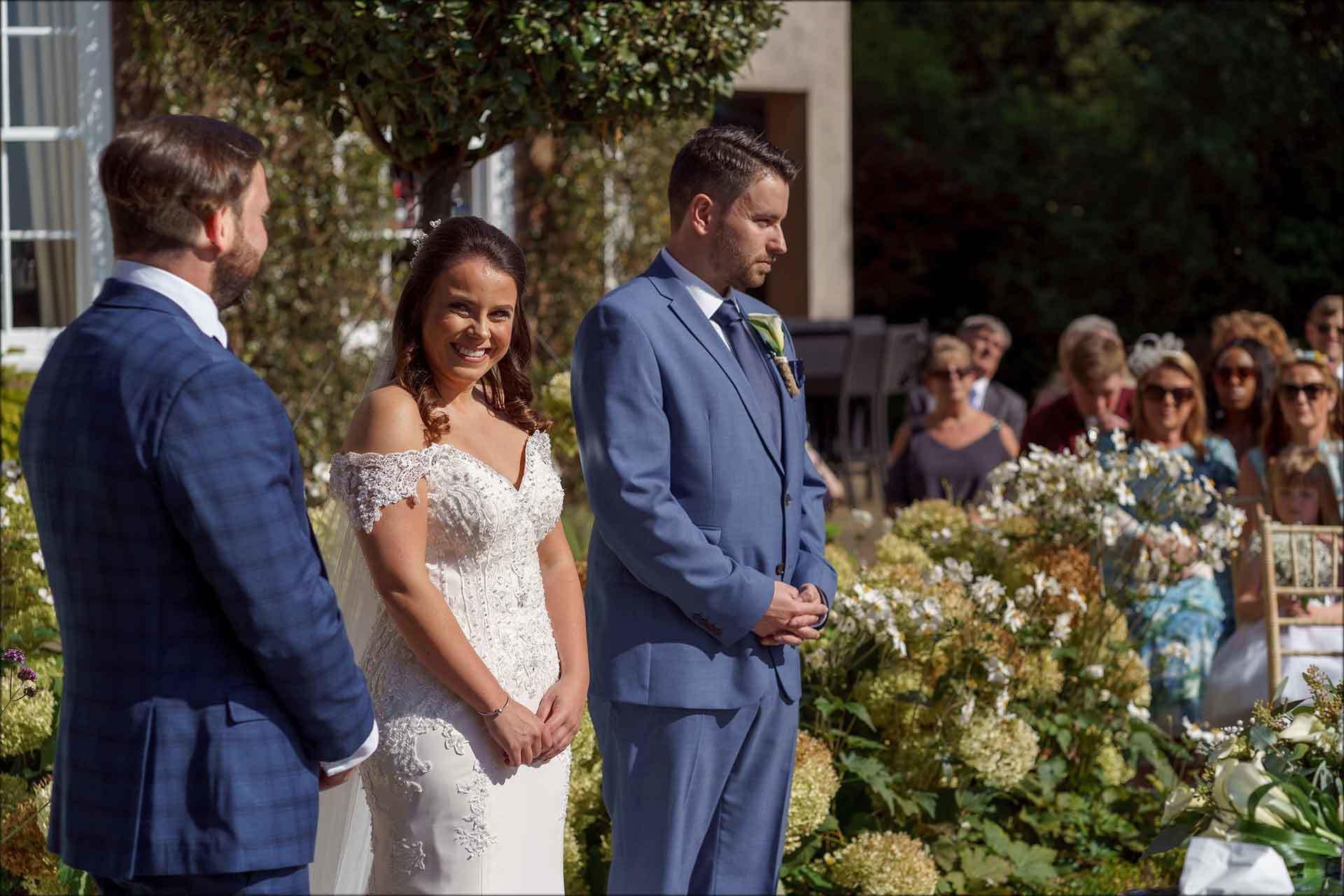 Smiling bride, sunny outdoor ceremony