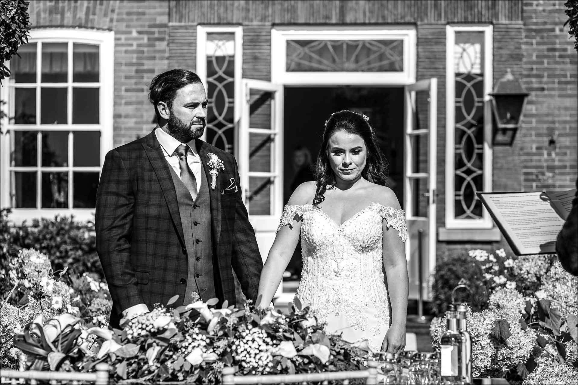 Bride and groom Delamere Manor outdoor wedding ceremony