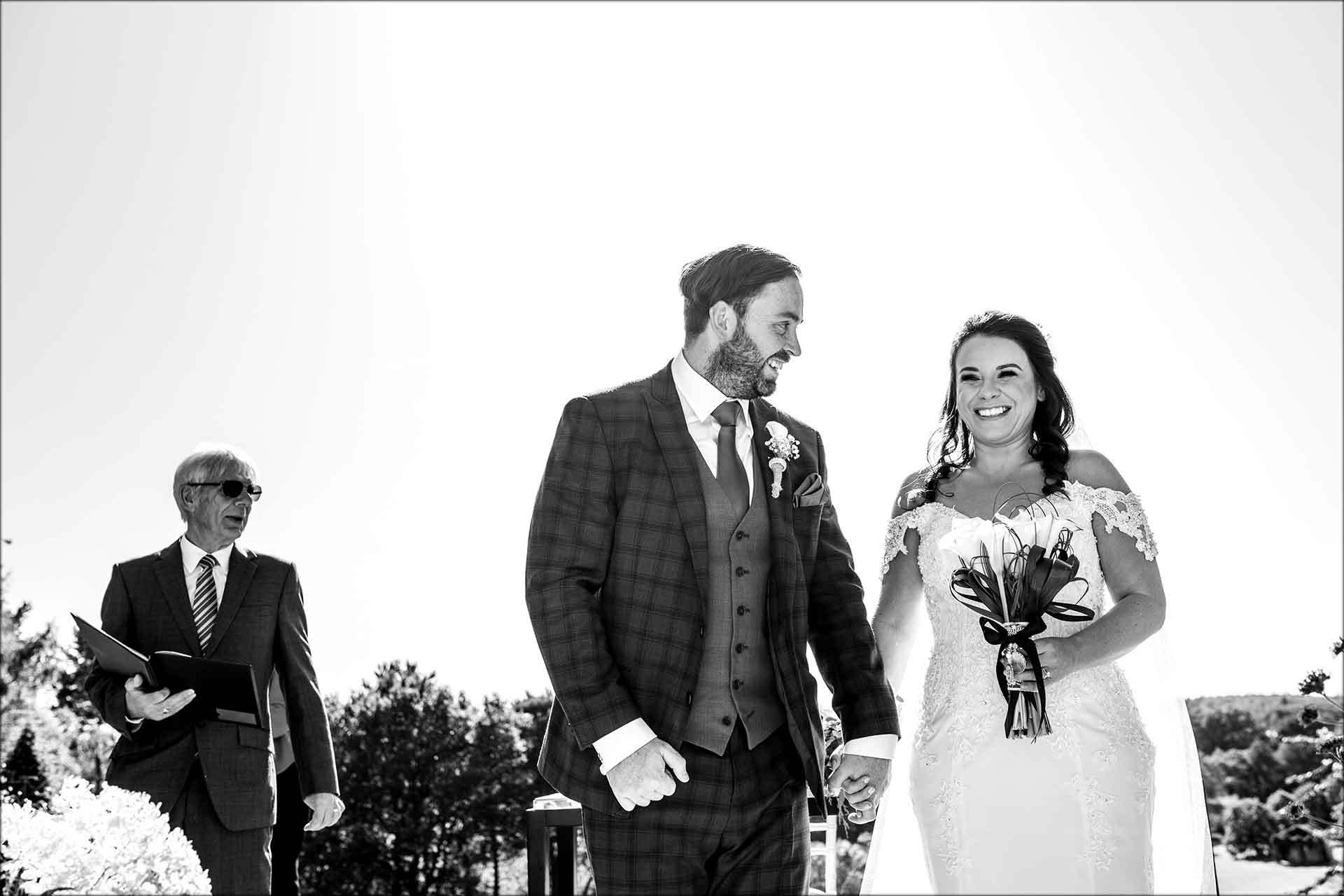 Bride and groom married at outdoor wedding ceremony