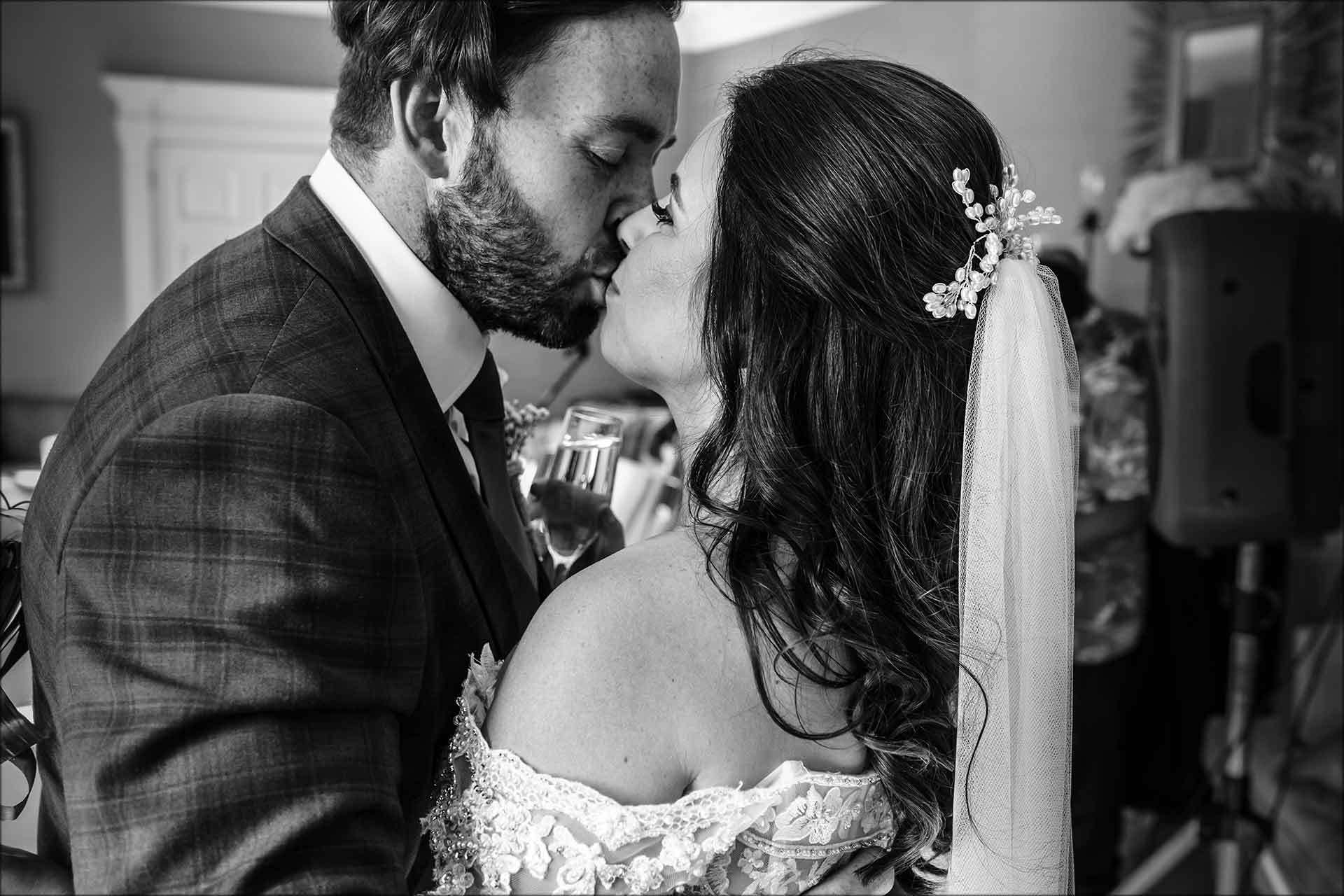 Bride and groom having a cheeky kiss