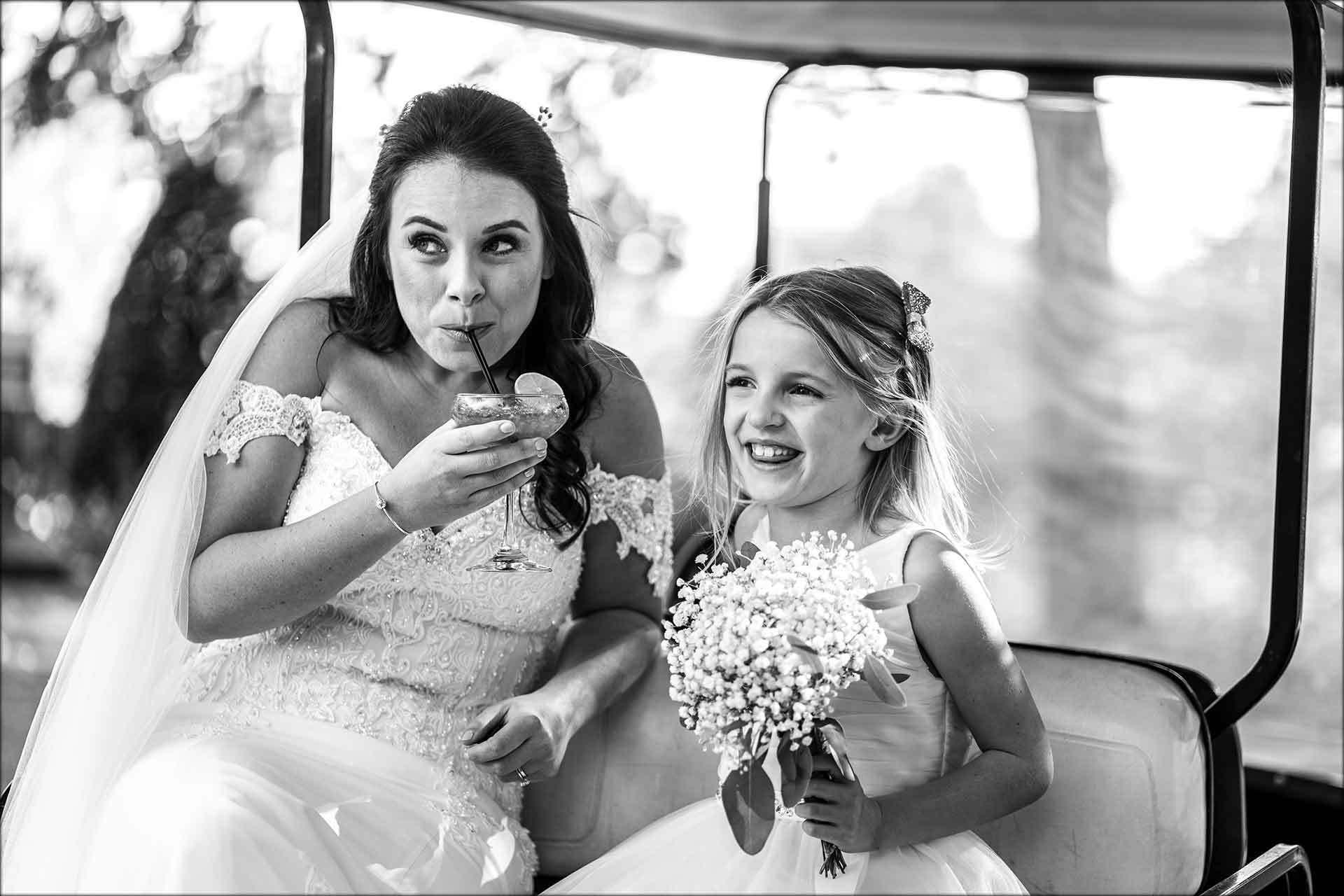 Bride sat in golf cart having a cocktail