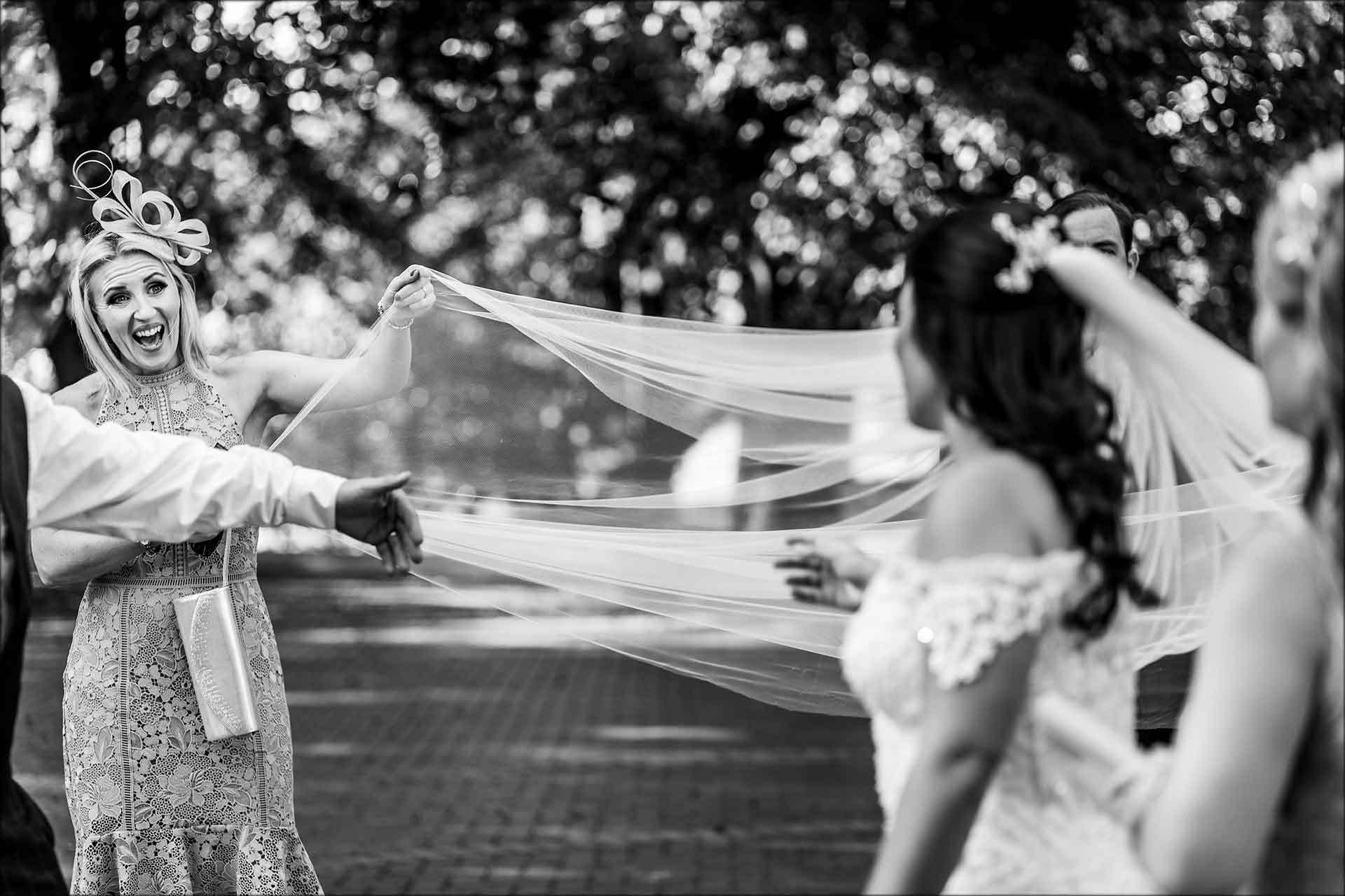 wind catches brides veil fun