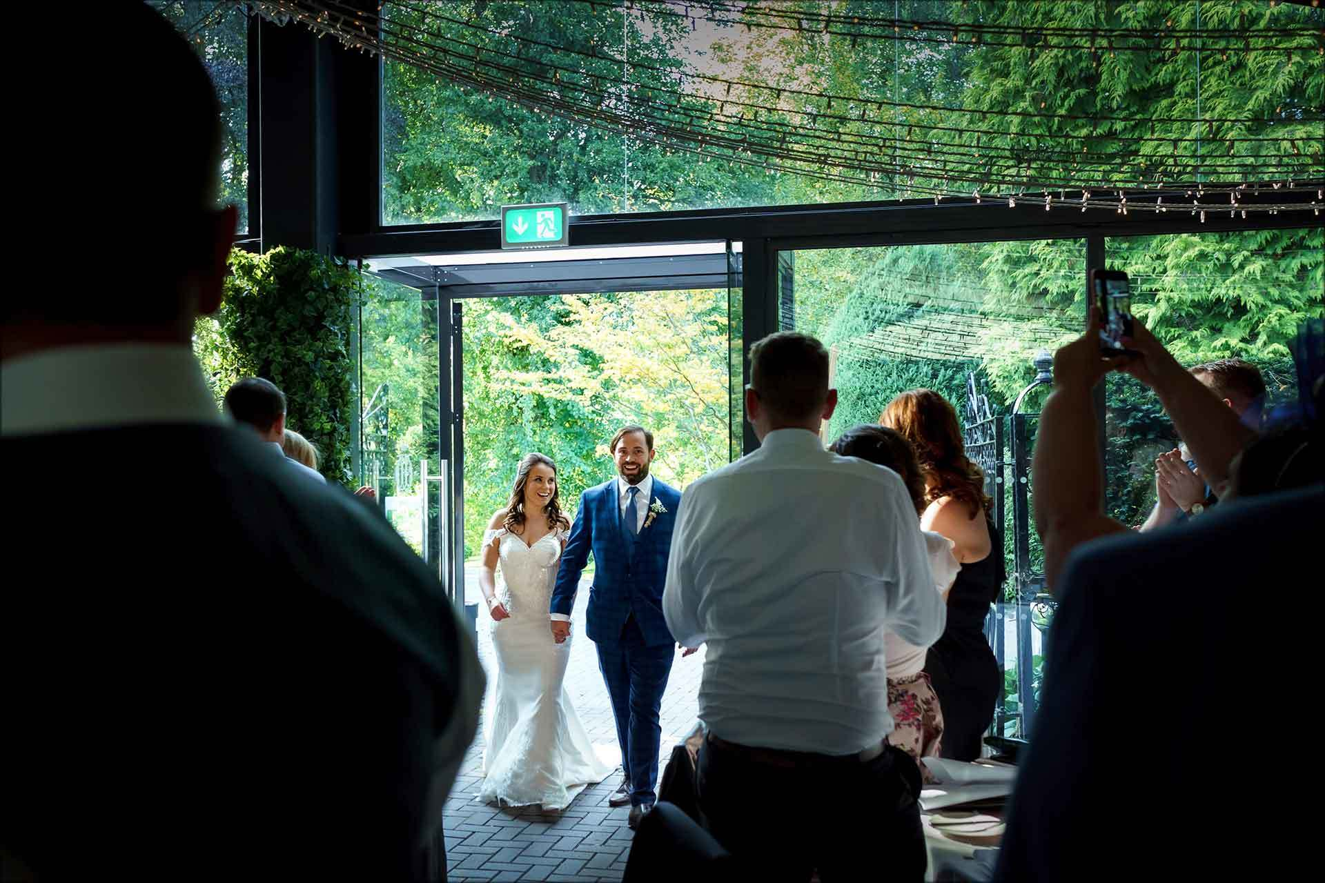 Bride and groom enter the room for the wedding breakfast