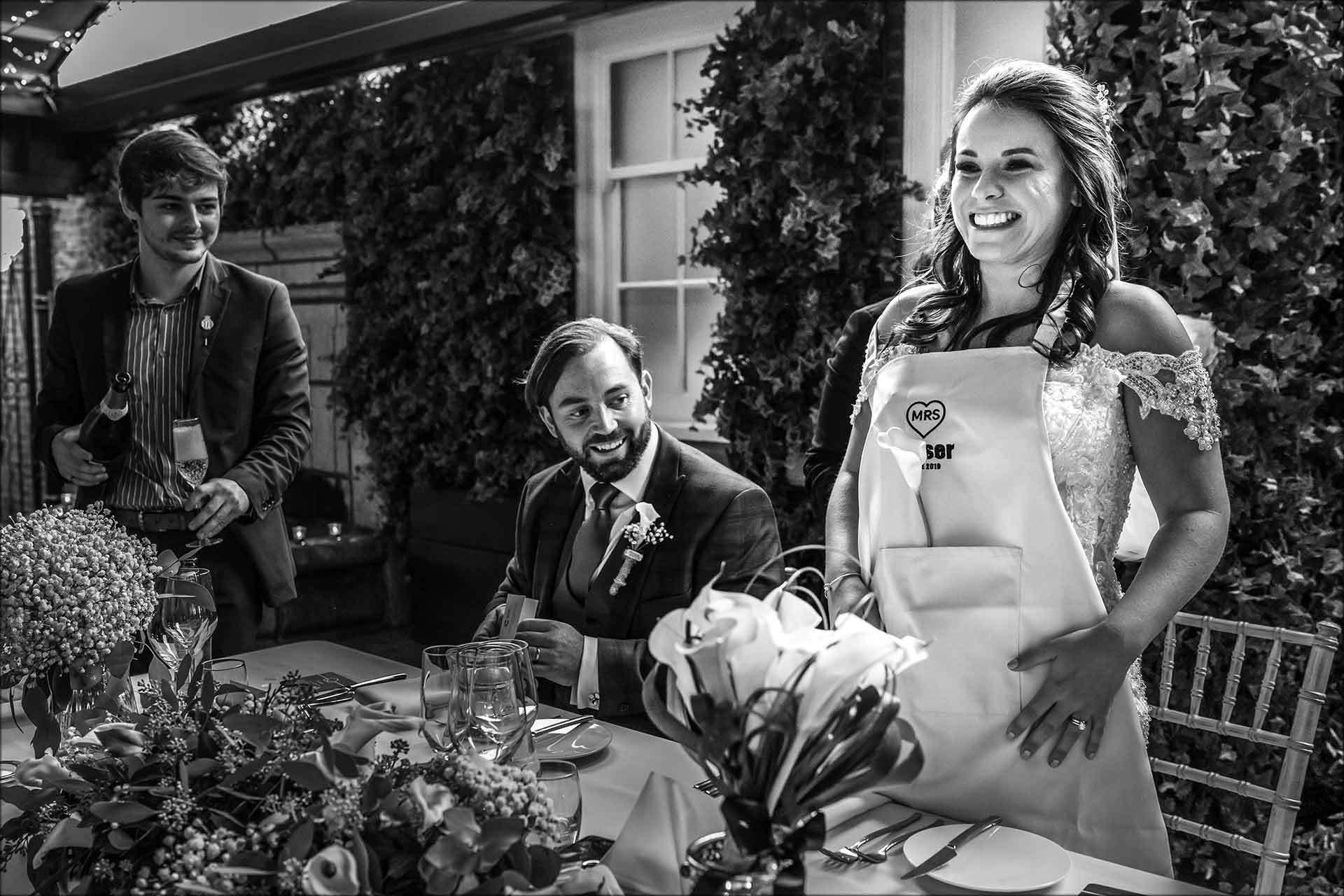 Bride wears apron to eat