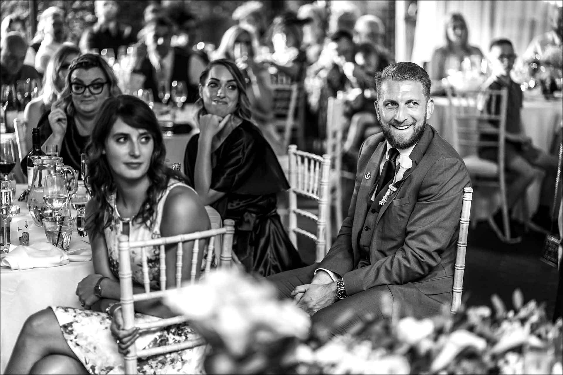 Laughing wedding guests during the speeches