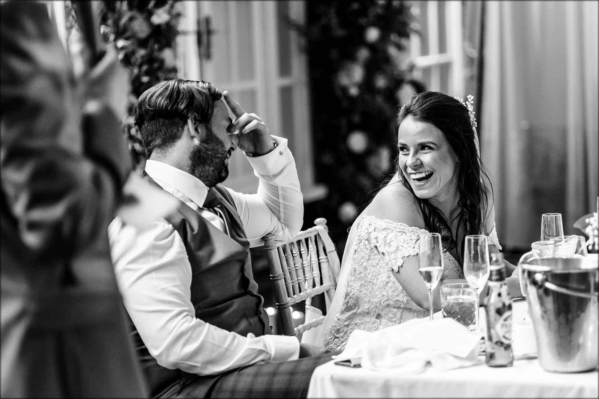 bride laughing at groom during the best mans speech at Delamere Manor