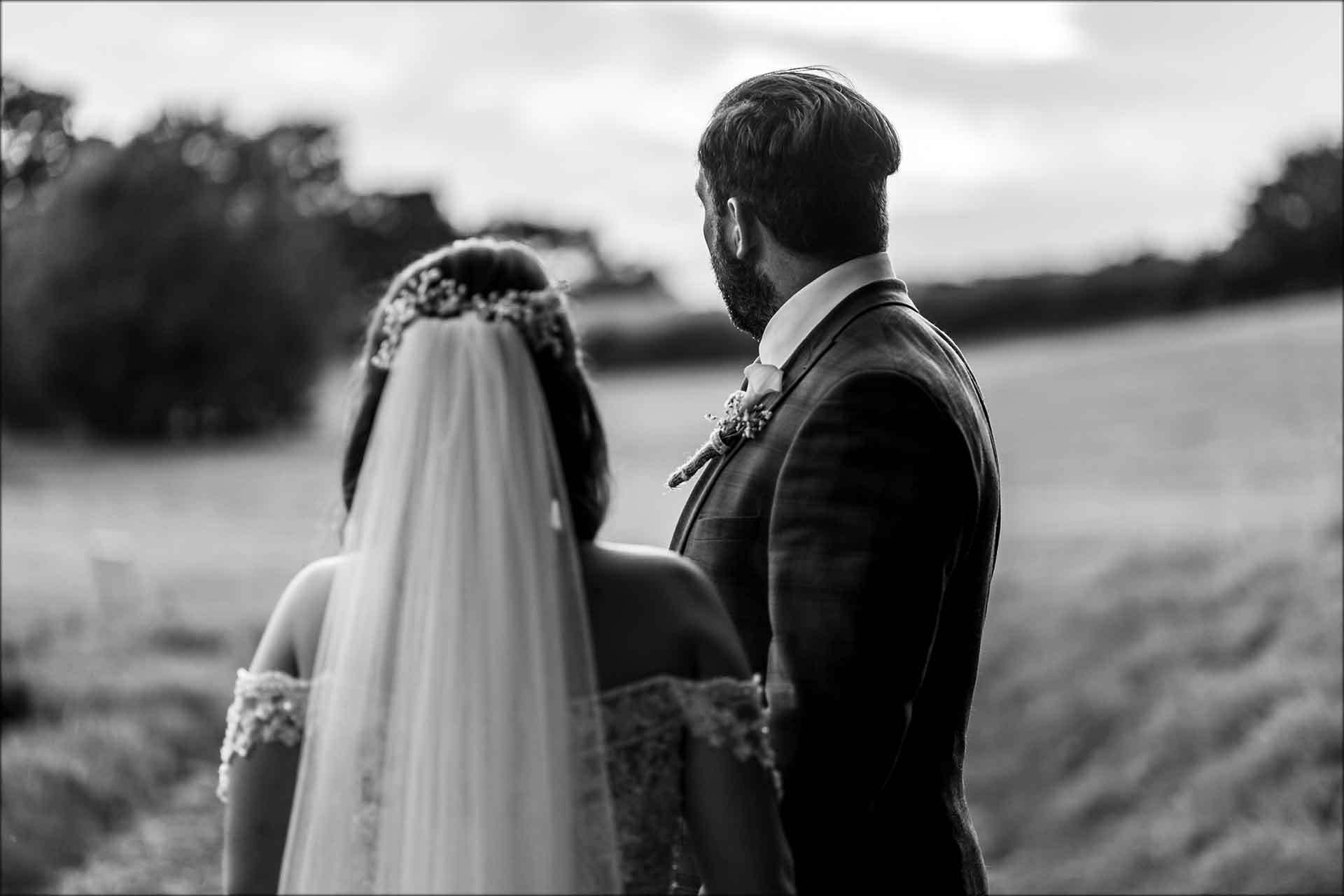 Couple look out over the grounds of Delamere Manor