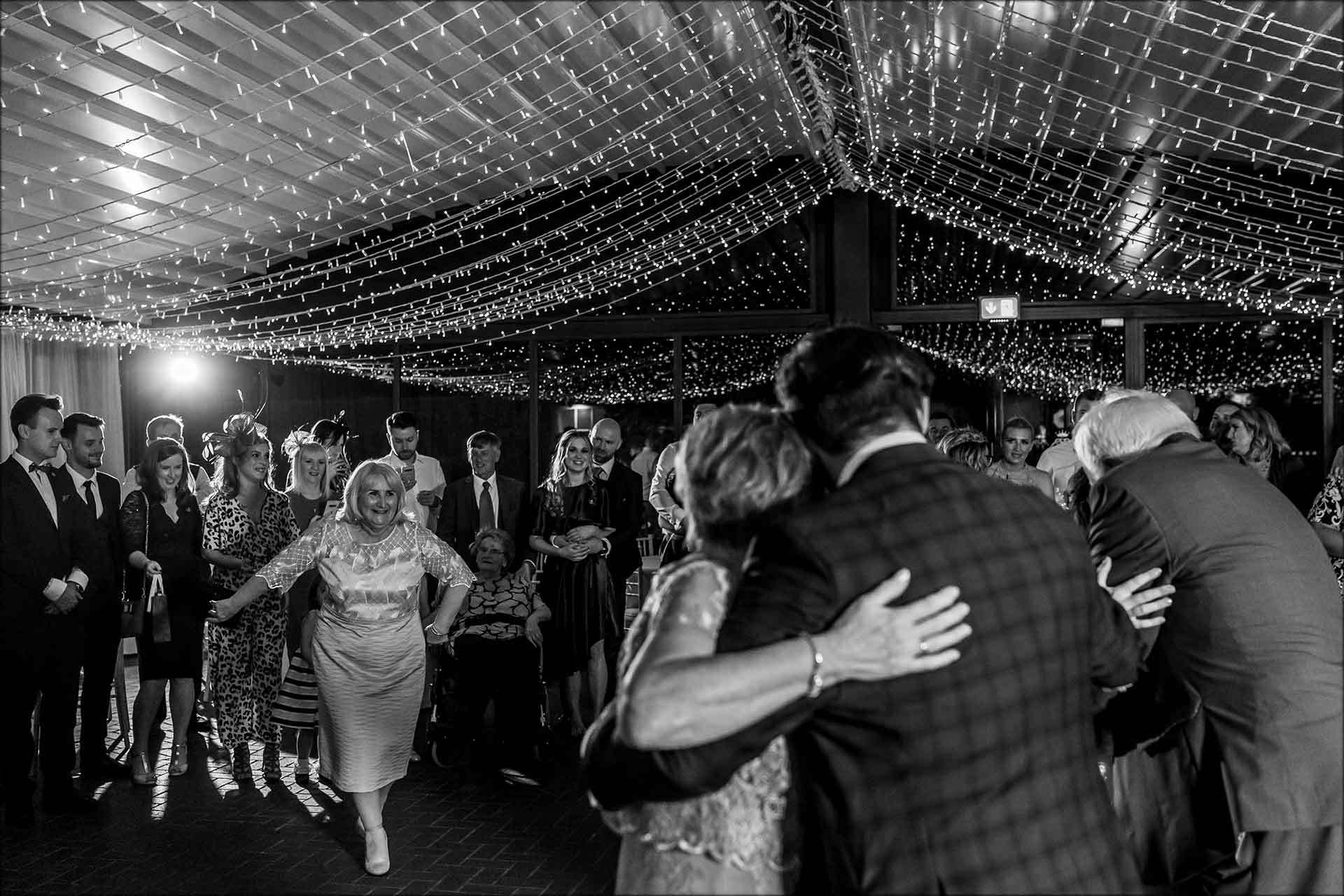 mum joins the bride and groom on the dancefloor