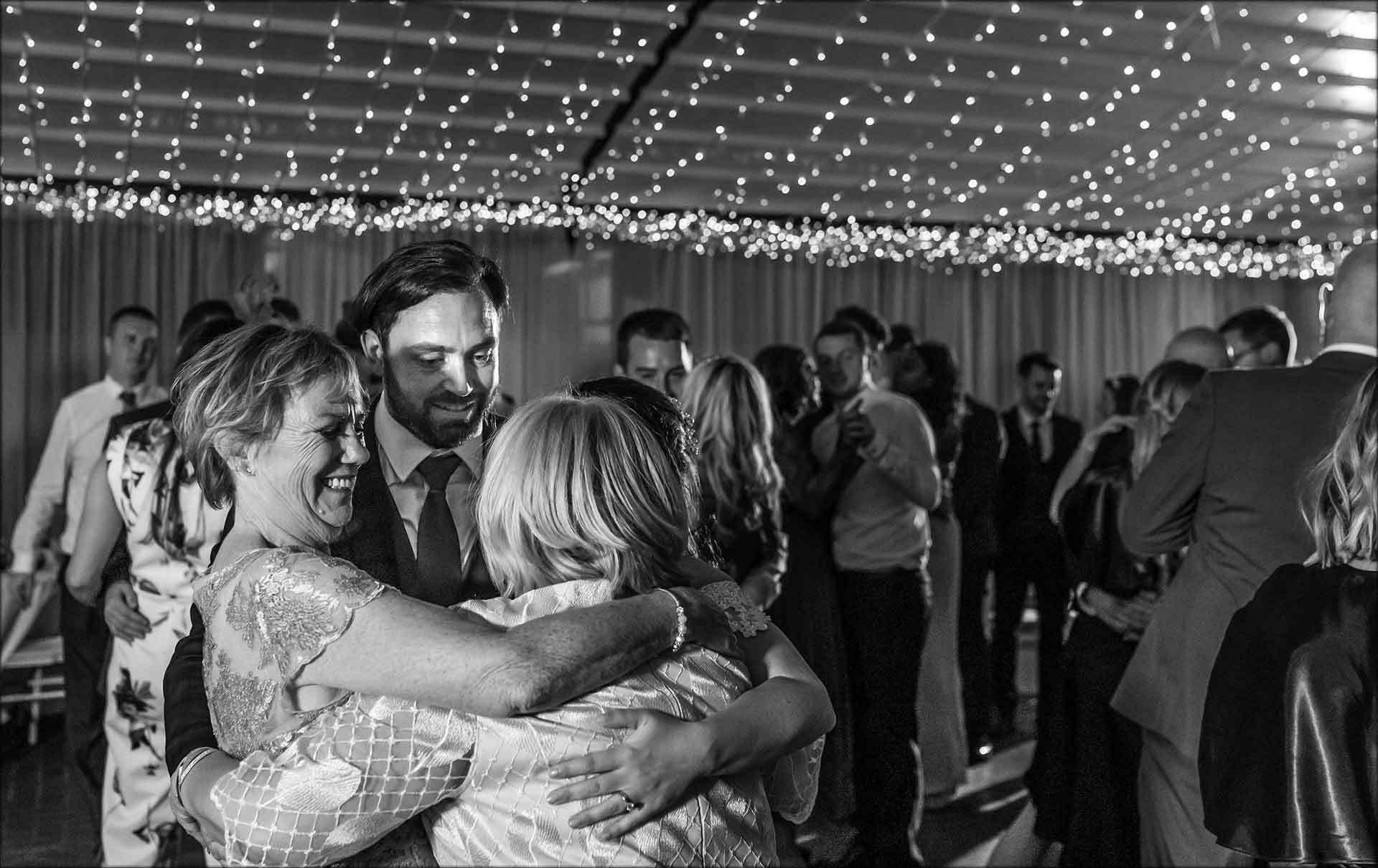 Family hug on the dancefloor