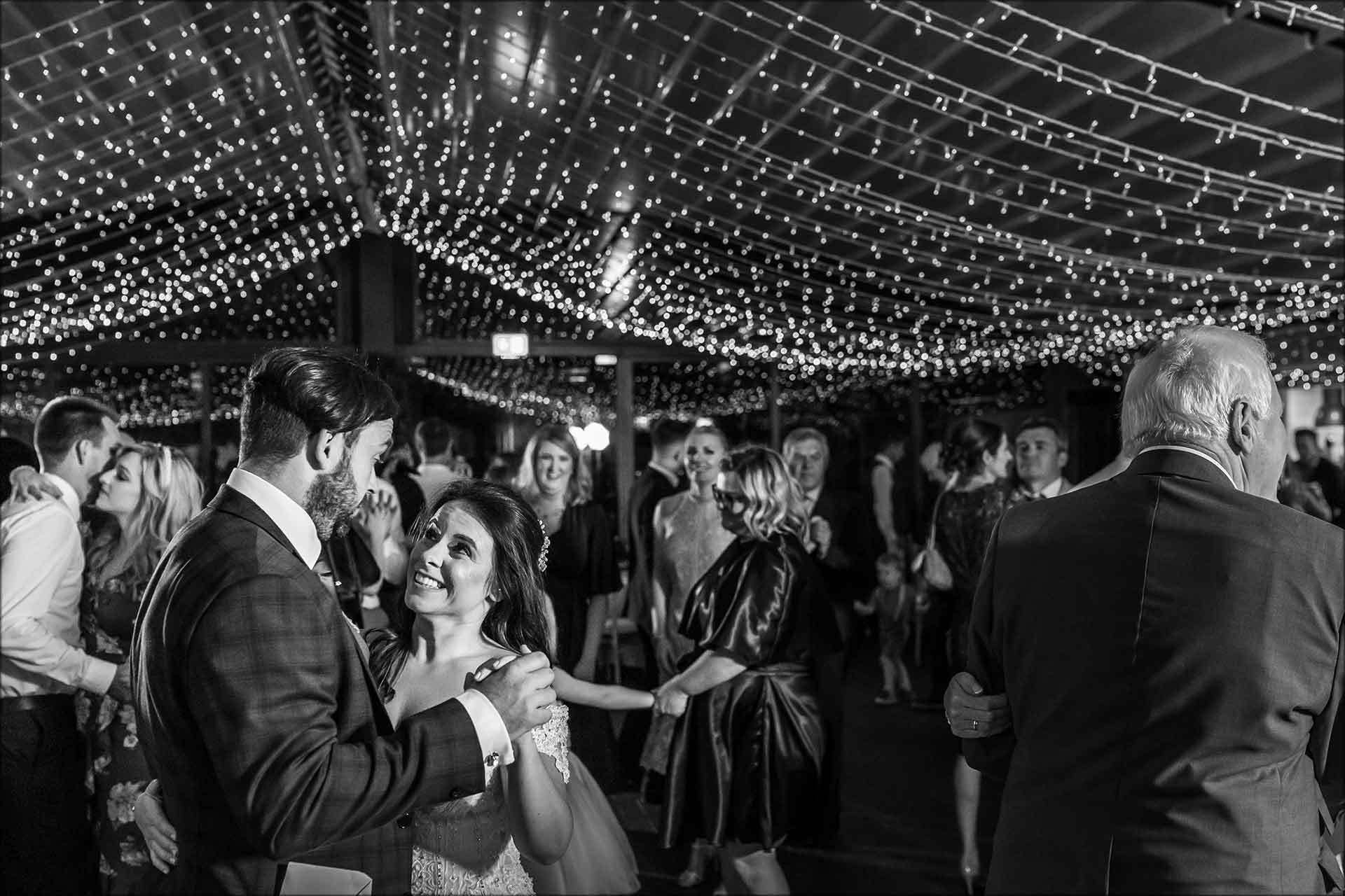Couple dancing with guests